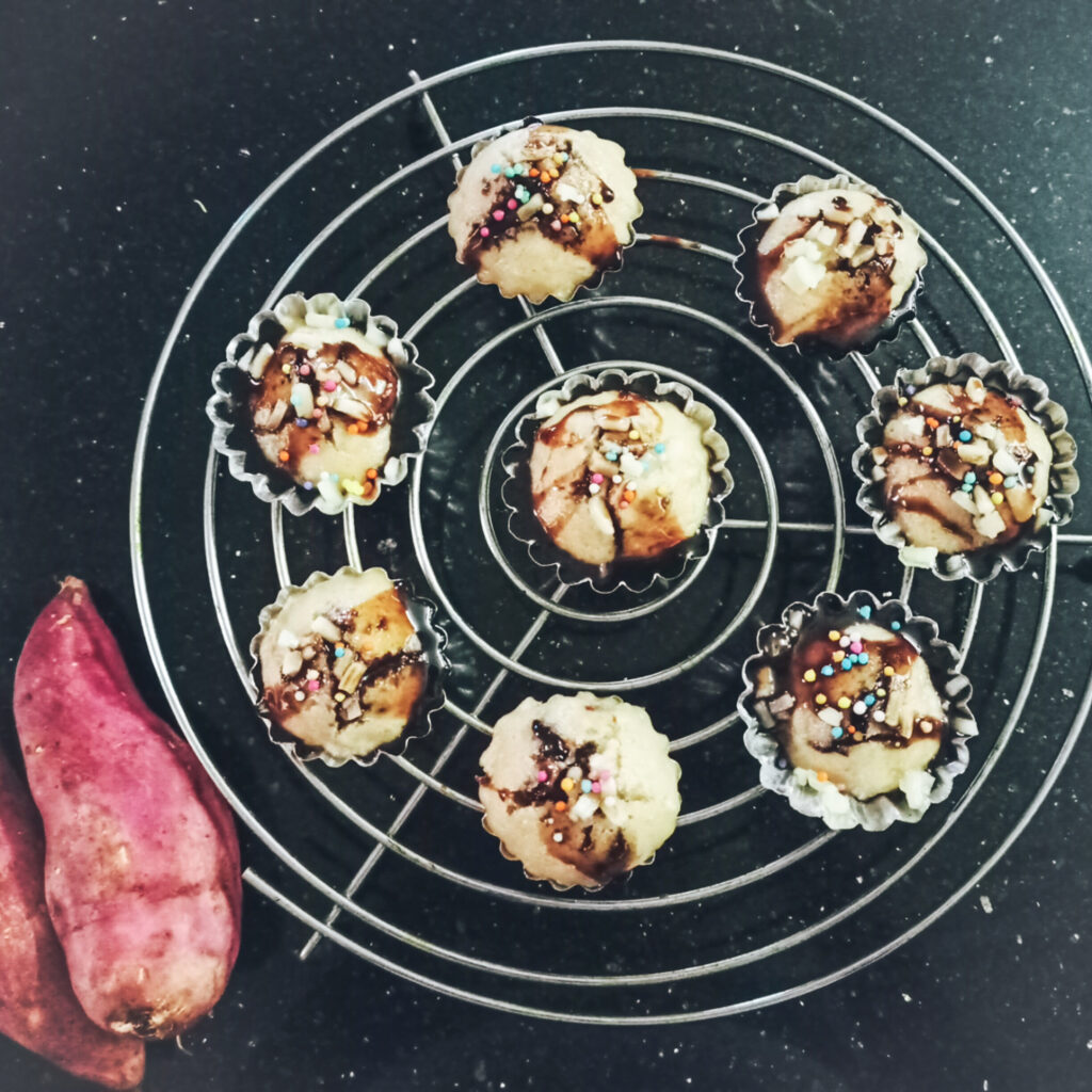 Sweet Potato Mini Muffins  served topped with  grated cheese , chocolate sauce or chocolate syrup and colourful sprinklers.